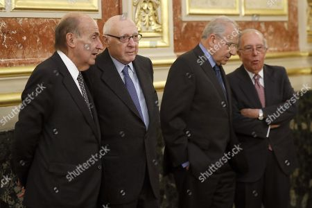Catalan jurist Miquel Roca (L), Jose Pedro Perez-Llorca, former Spanish Vice President Alfonso Guerra (2-R) and former Spanish Foreign Minister Marcelino Oreja (R) attend a ceremony held on occasion of the 40th anniversary of the Spanish Constitution at the Lower House in Madrid, Spain, 27 November 2017. Miquel Roca and Jose Pedro Perez-Lorca are two 'fathers' of the Constitution, two of the seven people who wrote the 1978 Constitution.