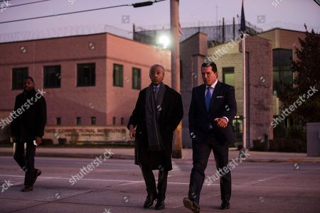 The Rev. Al Sharpton, center, accompanied by attorney Joe Tacopina, walks to speak with members of the media after visiting with rapper Meek Mill at the state correctional institution in Chester, Pa., . Mill was sentenced to serve two to four years in prison for violating probation in a nearly decade-old gun and drug case