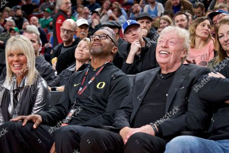 Penny Knight, Willie Taggart, Phil Knight. Penny Knight, left, Oregon football head coach Willie Taggart, center, and Nike co-founder Phil Knight, right, during the first half of an NCAA college basketball game in the Phil Knight Invitational tournament in Portland, Ore