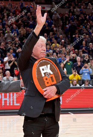 Nike co-founder Phil Knight during the first half of an NCAA college basketball game in the Phil Knight Invitational tournament in Portland, Ore