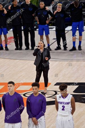 National Anthem singer Kyra Smith during the first half of an NCAA college basketball game in the Phil Knight Invitational tournament in Portland, Ore