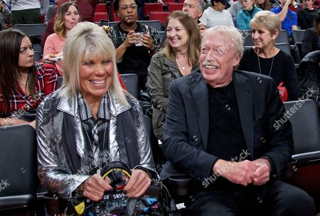 Phil Knight, Penny Knight. Phil Knight, right, and Penny Knight, left, during the first half of an NCAA college basketball game in the Phil Knight Invitational tournament in Portland, Ore