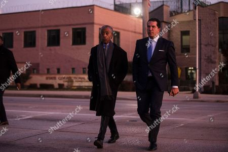 Stock Photo of The Rev. Al Sharpton, center, accompanied by attorney Joe Tacopina, walks to speak with members of the media after visiting with rapper Meek Mill at the state correctional institution in Chester, Pa., . Mill was sentenced to serve two to four years in prison for violating probation in a nearly decade-old gun and drug case