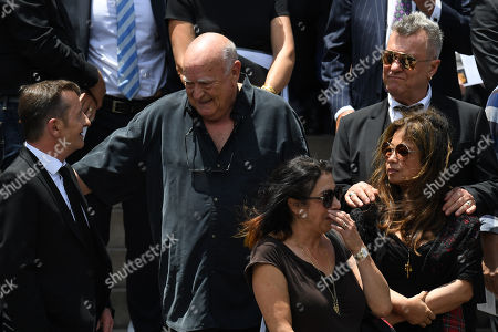 Stock Photo of Former AC/DC drummer Phil Rudd (L) chats with promoter Michael Chugg (C) and Jimmy Barnes (R) as they are joined family, friends and fellow musicians for the funeral of late AC/DC co-founder and guitarist Malcolm Young at St. Mary's Cathedral in Sydney, New South Wales, Australia, 28 November 2017. Malcolm, along with his brother Angus Young founded the iconic rock group AC/DC. Malcolm Young died at the age of 64 on 18 November 2017.