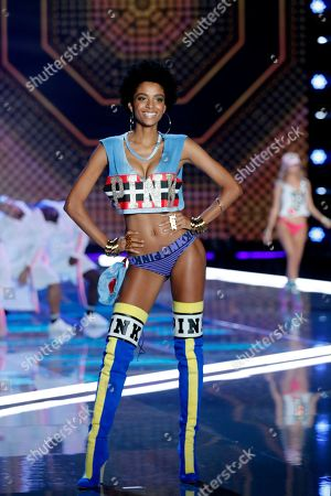 African model Alecia Morais presents a Pink collection during the Victoria's Secret fashion show at the Mercedes-Benz Arena in Shanghai, China on