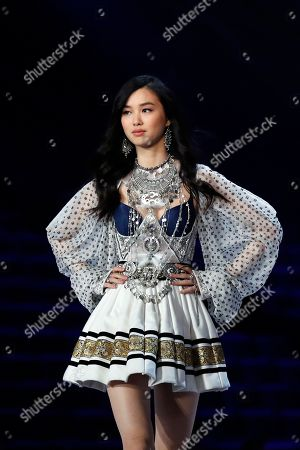 French model Estelle Chen presents a creation during the Victoria's Secret fashion show at the Mercedes-Benz Arena in Shanghai, China on