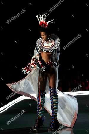 Model Amilna Estevao presents a creation during the Victoria's Secret fashion show at the Mercedes-Benz Arena in Shanghai, China on
