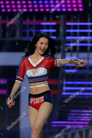 Chinese model Xin Xie presents a Pink collection during the Victoria's Secret fashion show at the Mercedes-Benz Arena in Shanghai, China on