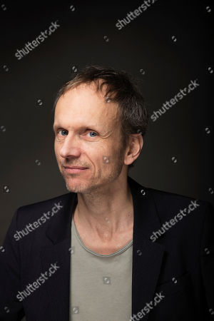 """Director Julian Rosefeldt poses for a portrait to promote the film, """"Manifesto"""", at the Music Lodge during the Sundance Film Festival, in Park City, Utah"""