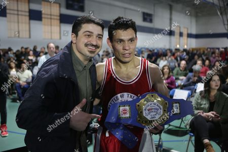 Chicago Fire actor Yuri Sardarov congratulates Juan Dietz of the Chicago Fire Department on his victory in the first bout of The Battle of the Badges presented by COUNTRY Financial, in Chicago