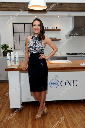 Stock Picture of Celebrity chef and wellness journalist Candice Kumai celebrates the launch of Febreze ONE at a cooking demonstration inspired by and incorporating the product's single-note scents of Bamboo, Orchid and Mandarin, in New York. Febreze ONE's two-in-one formula gently cleans away odors from both the air and fabric with no heavy perfumes, no aerosols and no dyes
