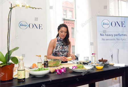 Stock Image of Celebrity chef and wellness journalist Candice Kumai celebrates the launch of Febreze ONE at a cooking demonstration inspired by and incorporating the product's single-note scents of Bamboo, Orchid and Mandarin, in New York. Febreze ONE's two-in-one formula gently cleans away odors from both the air and fabric with no heavy perfumes, no aerosols and no dyes