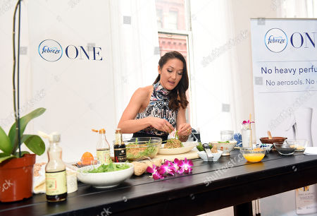 Celebrity chef and wellness journalist Candice Kumai celebrates the launch of Febreze ONE at a cooking demonstration inspired by and incorporating the product's single-note scents of Bamboo, Orchid and Mandarin, in New York. Febreze ONE's two-in-one formula gently cleans away odors from both the air and fabric with no heavy perfumes, no aerosols and no dyes