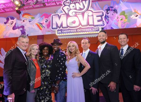 MY LITTLE PONY: The Movie stars Uzo Aduba, third left, Taye Diggs center left, and Tara Strong, center, join Hasbro's Chairman and CEO, Brian Goldner, right, Hasbro Studios Executive Vice President, Chief Content Officer Stephen Davis, left, President of Hasbro, John Frascotti, center right, and Co-Heads of Storytelling for Hasbro, Meghan McCarthy, second left, and Josh Feldman, second right, in New York, at the Hasbro Entertainment Preview Event. MY LITTLE PONY: The Movie will be in theatres October 6, 2017