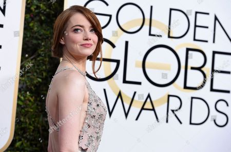 Emma Stone arrives at the 74th annual Golden Globe Awards at the Beverly Hilton Hotel in Beverly Hills, Calif. Madonna, Stone, Willow Smith and first lady Michelle Obama are among 150 women chosen by editors of Harper's Bazaar as the worldâ?™s most fashionable, the list was released
