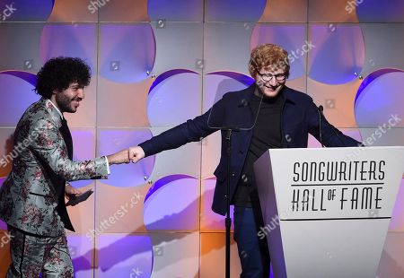 Stock Image of Singer-songwriter Ed Sheeran, right, thanks his presenter, Benny Blanco, during his acceptance speech for the Hal David Starlight Award at the 48th Annual Songwriters Hall of Fame Induction and Awards Gala at the New York Marriott Marquis Hotel, in New York