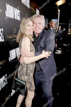 """Stock Image of Steffanie Sampson and Gary Busey seen at Summit Entertainment, a Lionsgate Company, Los Angeles Premiere of """"John Wick Chapter 2"""" at ArcLight Hollywood, in Los Angeles"""