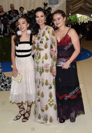 Chloe Murdoch, from left, Wendi Deng, and Grace Helen Murdoch attend The Metropolitan Museum of Art's Costume Institute benefit gala celebrating the opening of the Rei Kawakubo/Comme des Garçons: Art of the In-Between exhibition, in New York