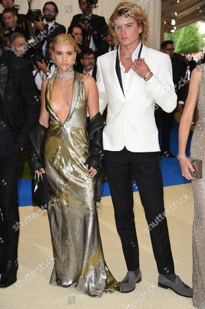 Stock Photo of Sofia Richie, left, and Jordan Kale Barrett attend The Metropolitan Museum of Art's Costume Institute benefit gala celebrating the opening of the Rei Kawakubo/Comme des Garçons: Art of the In-Between exhibition, in New York