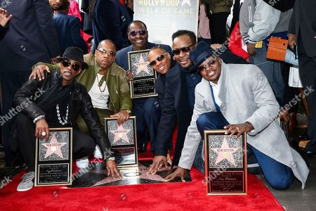 Ralph Tresvant, from left, Michael Bivins, Johnny Gill, Ronnie DeVoe, Bobby Brown and Ricky Bell attend a ceremony honoring New Edition with a star on the Hollywood Walk of Fame, in Los Angeles