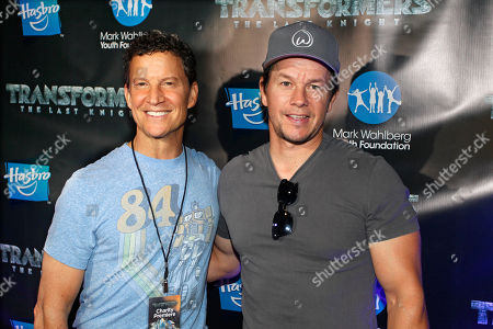 TRANSFORMERS: THE LAST KNIGHT star, Mark Wahlberg, right, and Brian Goldner, Hasbro Chairman & CEO and Executive Producer of TRANSFORMERS: THE LAST KNIGHT, walk the red carpet at the TRANSFORMERS: THE LAST KNIGHT Charity Premiere with the Mark Wahlberg Youth Foundation at Showcase LIVE, Patriot Place in Foxborough, Mass
