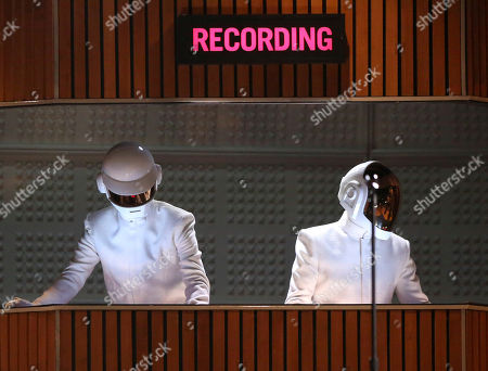 Thomas Bangalter, left, and Guy-Manuel de Homem-Christo of Daft Punk perform at the 56th annual Grammy Awards at Staples Center in Los Angeles. The Weeknd will team up for a performance with Daft Punk at the Grammy Awards on Feb. 12, 2017. The collaboration between the singer and the electronic music duo is one of a number of pairings announced Tuesday, Jan. 31, 2017