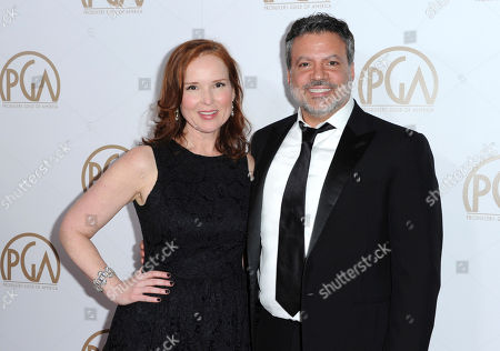 Oscars producers Jennifer Todd, left, and Michael De Luca at the 27th Annual Producers Guild Awards in Los Angeles. Although the first-time Oscar telecast producers may want their show to focus on the magic of the movies, they say they support any message spoken from the heart, even if it means turning the Oscar podium into a political pulpit
