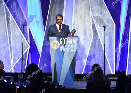 "Stock Photo of Director Jordan Peele accepts the Bingham Ray Breakthrough director award for ""Get Out"" at the 27th annual Independent Film Project's Gotham Awards at Cipriani Wall Street, in New York"