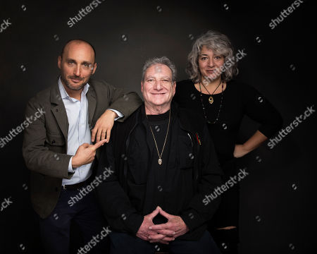 "Stock Photo of Amir Bar-Lev, from left, Steve Parish and Trixie Garcia pose for a portrait to promote the film, ""Long Strange Trip"", at the Music Lodge during the Sundance Film Festival, in Park City, Utah"