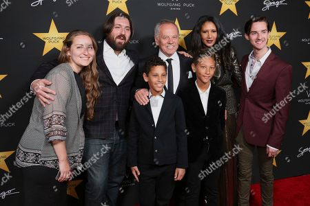 Wolfgang Puck, center, Gelila Assefa, second right, and their sons, front, Oliver, and Alexander, Cameron, second left, and Byron, right, arrive at the Wolfgang Puck's Post-Hollywood Walk of Fame Star Ceremony Celebration at Spago, in Beverly Hills, Calif