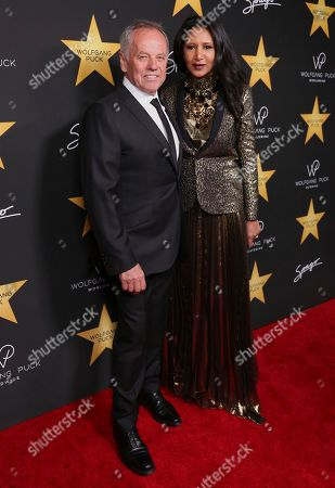 Gelila Assefa, right, and Wolfgang Puck arrive at the Wolfgang Puck's Post-Hollywood Walk of Fame Star Ceremony Celebration at Spago, in Beverly Hills, Calif