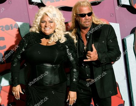 """Beth Chapman, left, and Duane Chapman arrive at the CMT Music Awards at Bridgestone Arena, in Nashville, Tenn. The chairman of the Honolulu Police Commission wants the wife of """"Dog the Bounty Hunter"""" reality TV star Duane """"Dog"""" Chapman to have a role in selecting the city's next police chief. Chairman Max Sword says he's known Beth Chapman personally for a long time and thinks her background in the bail bonds business will be helpful"""