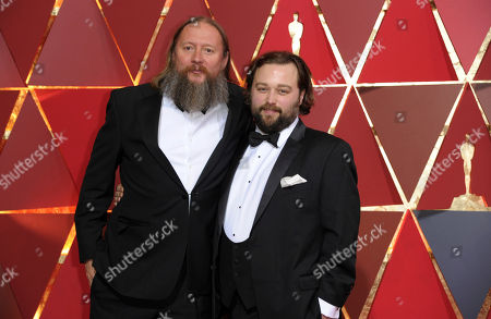Stock Photo of David Mackenzie, left, and Jake Roberts arrive at the Oscars, at the Dolby Theatre in Los Angeles