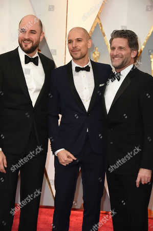 Stock Photo of Jordan Horowitz, from left, Fred Berger and Gary Gilbert arrive at the Oscars, at the Dolby Theatre in Los Angeles