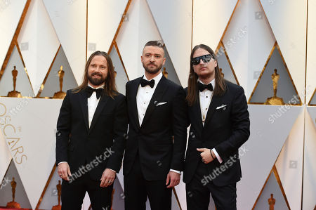 Stock Image of Max Martin, from left, Justin Timberlake, and Karl Johan Schuster arrive at the Oscars, at the Dolby Theatre in Los Angeles