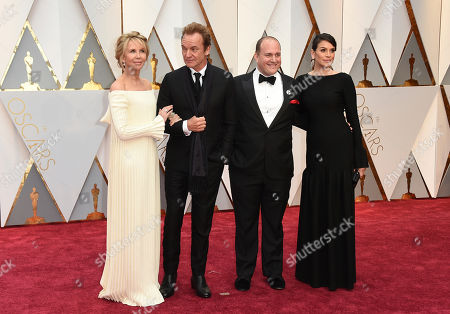 Stock Picture of Trudie Styler, from left, Sting, J. Ralph, and Sarah Strayer arrive at the Oscars, at the Dolby Theatre in Los Angeles