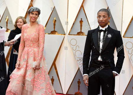Mimi Valdes, left, and Pharrell arrive at the Oscars, at the Dolby Theatre in Los Angeles