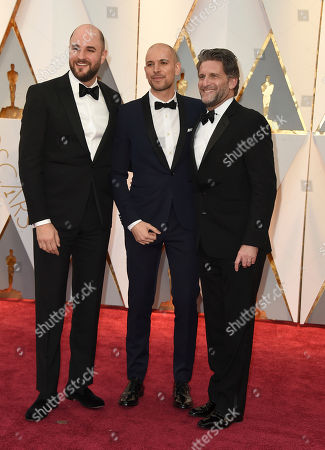 Jordan Horowitz, from left, Fred Berger and Gary Gilbert arrive at the Oscars, at the Dolby Theatre in Los Angeles