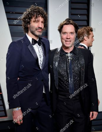 Jorn Weisbrodt, left, and husband Rufus Wainwright arrive at the Vanity Fair Oscar Party, in Beverly Hills, Calif