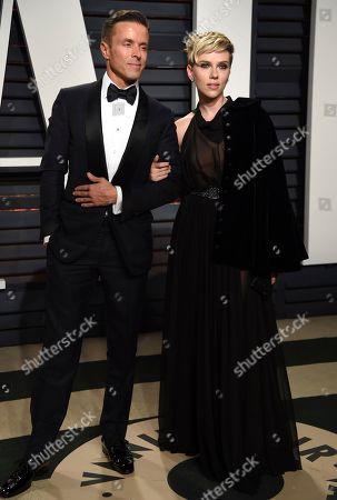 Joe Machota, left, and Scarlett Johansson arrive at the Vanity Fair Oscar Party, in Beverly Hills, Calif