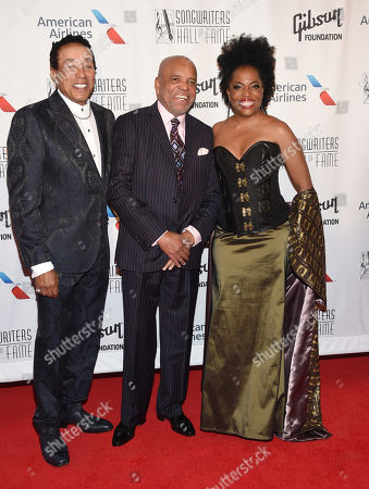 Smokey Robinson, from left, and Berry Gordy and Rhonda Ross Kendrick attend the the 48th Annual Songwriters Hall of Fame Induction and Awards Gala at the New York Marriott Marquis Hotel, in New York