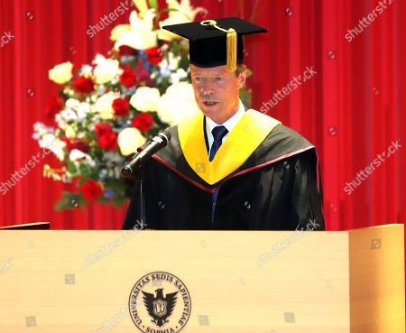 Grand Duke Henri of Luxembourg delivers a speech as he receives an honorary doctorate from Japan's Sophia University in Tokyo