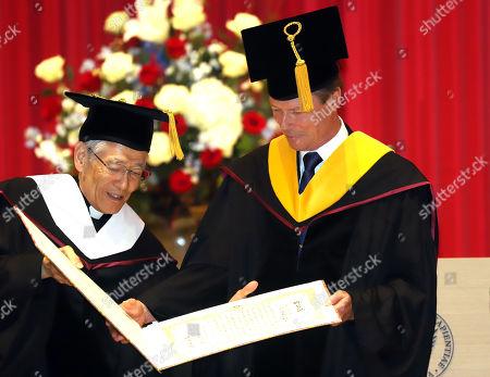 Grand Duke Henri of Luxembourg receives honorary doctorate from Japan's Sophia University chancellor Toshiaki Koso (L) at Sophia University in Tokyo