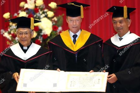 Grand Duke Henri of Luxembourg receives honorary doctorate from Japan's Sophia University president Yoshiaki Terumichi (R) and chancellor Toshiaki Koso (L) at Sophia University in Tokyo
