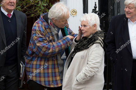 Stock Photo of Actress Dame Judi Dench wipes her eye before unveiling a blue plaque commemorating Sir John Gielgud in central London, outside the Westminster home where he lived for 31-years, . The blue plaque commemorates the famed English actor and director Gielgud whose career spanned eight decades until his death in May 2000