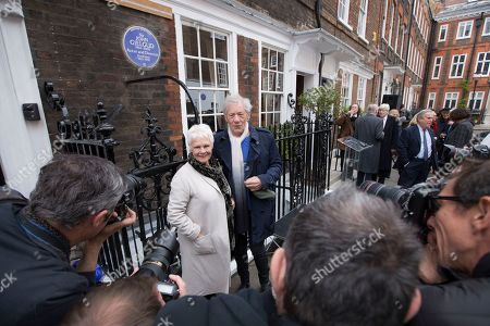 Actress Judi Dench is photographed as she is joined by Ian McKellen after unveiling a blue plaque commemorating Sir John Gielgud in central London, outside the Westminster home where he lived for 31-years, . The blue plaque the famed English actor and director Gielgud whose career spanned eight decades until his death in May 2000