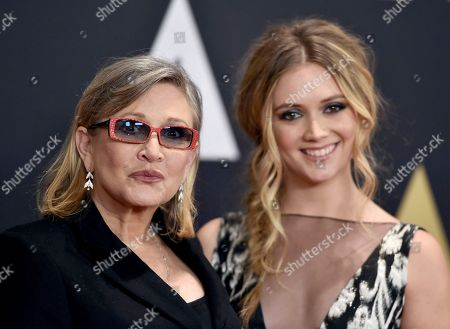 """Carrie Fisher, left, and her daughter Billie Catherine Lourd arrive at the Governors Awards at the Dolby Ballroom in Los Angeles. Fisher, a daughter of Hollywood royalty who gained pop-culture fame as Princess Leia in the original """"Star Wars"""" and turned her struggles with addiction and mental illness into wickedly funny books, a hit film and a one-woman stage show, died"""