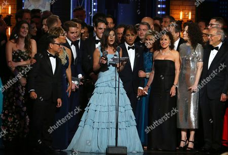 """Stacey Mindich and the cast and crew of """"Dear Evan Hansen"""" accept the award for best musical at the 71st annual Tony Awards, in New York"""
