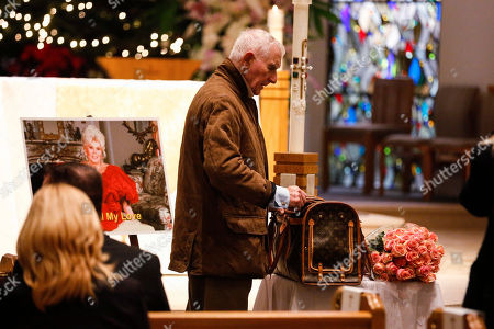 """Frederic Von Anhalt attends wife Zsa Zsa Gabor's """"Celebration of Life"""" memorial service at the Good Shepherd Church, in Beverly Hills, Calif. Von Anhalt told People magazine for an article published online Jan. 12, 2017, that his late wifeâ?™s ashes are being kept at home even though her former publicist says that was against Gaborâ?™s wishes and a family plot is waiting for her at a Los Angeles cemetery"""
