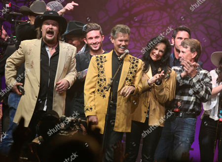 """Travis Tritt, from left, Michael Ray, Randy Travis, Mary Travis and Ricky Traywick appear on stage at the """"1 Night. 1 Place. 1 Time.: A Heroes and Friends Tribute to Randy Travis"""" at Bridgestone Arena on in Nashville, Tenn"""